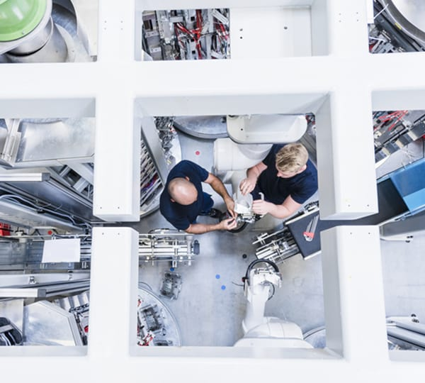 aerial view of 2 people working together