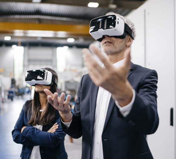man and woman wearing VR goggles